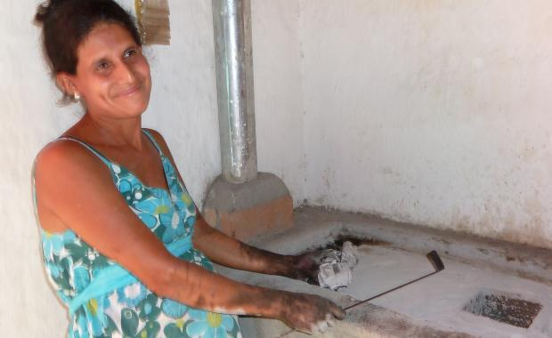 This woman in Machaloa was cleaning her stove when the Supervisor showed up to ask her about maintenance.
